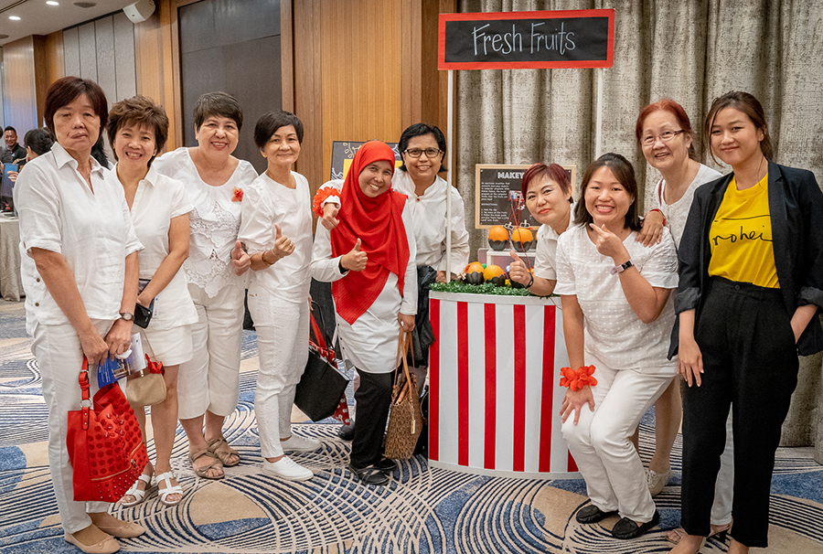 Wan QI and the PAP Women's Wing activists at the Makey Makey station of our Pasar Innovation booth